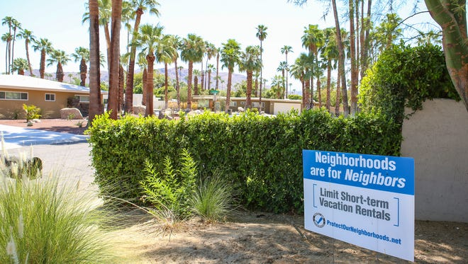 Jay Calderon/The Desert Sun A resident's front yard sign advocates for limiting short-term vacation rentals in the Deepwell neighborhood in Palm Springs oi August 2016. The Palm Springs City Council will meet at 6 p.m. Wednesday to discuss a revised vacation rentals ordinance that limits how many times a home can be rented and and puts to work the city's newly formed short term rental enforcement division.
