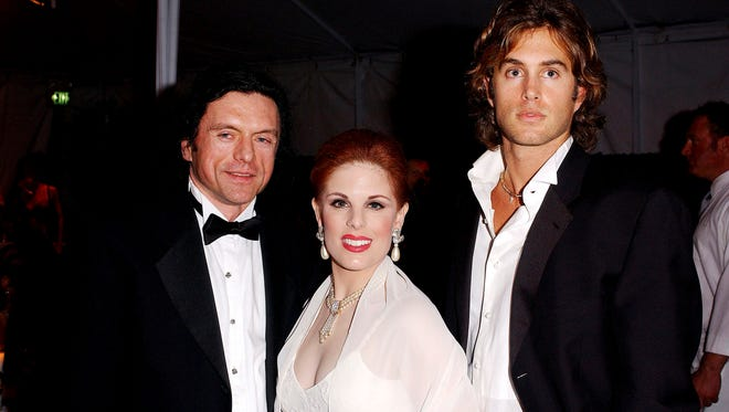 WEST HOLLYWOOD, CA - FEBRUARY 29: (US TABS AND HOLLYWOOD REPORTER OUT) Director Tommy Wiseau, Kat Kramer and actor Greg Sestero (l-r) attend the Oscar Night Benefit Party for Amnesty International and the ACLU Foundation on February 29, 2004 at Ago in West Hollywood, California. (Photo by Amanda Edwards/Getty Images)