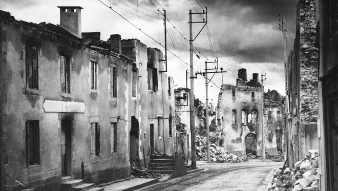 Here's the main street of Oradour sur Glane, France shown in 1952 after it was burned and sacked by the Nazis on June 10, 1944 in a massacre in which 642 persons, including 246 children, died as victims of a German column. The town has been left as a permanent witness to the atrocity, and a new town has been built a few miles from this site.