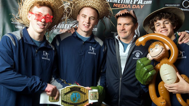 Dallastown wrestling members Cael Turnbull, Garrett Johnson, Dalton Daugherty and coach Dave Gable, November 11, 2017. Teams from around the YAIAA had fun posing with props for GameTimePa's photo booth.