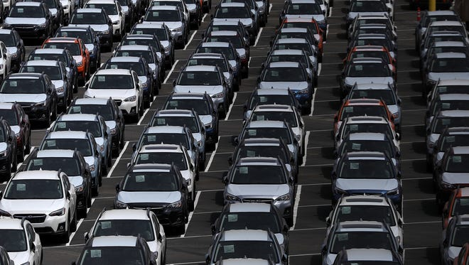 Brand new cars sit in a lot at the Auto Warehousing Company near the Port of Richmond on May 24, 2018 in Richmond, California.  U.S. president Donald Trump is threatening to impose heavy tariffs on auto imports and has directed Commerce secretary Wilbur Ross to look into and determine if auto imports could be considered a national security threat and if it would be possible to bypass congress and take unilateral action under section 232 of the Trade Expansion Act of 1962.