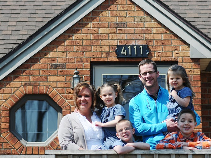 From left, Molly Wilson, Nev Wilson, 4, Brian Wilson, 5, Joe Wilson, Kate Wilson, 3, and Sebastian Wilson, 8, pose for a photo on Friday, April 18, 2014, at their home in Sioux Falls. (Joe Ahlquist / Argus Leader)