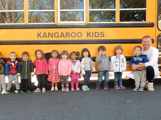 Assistant Director at Kangaroo Kids, Shaun Pidany, teaches the Discovery Preschool Class about Bus Safety.