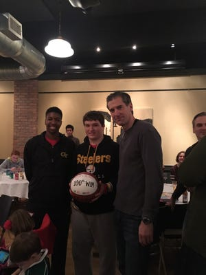 Glen Ridge coach Liam Carr receiving recognition from two of his captains, Max Thompson (left) and Ryan Liddy, for his 100th career win.