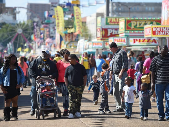 The mile-long Midway bustles at the Mississippi State Fair.