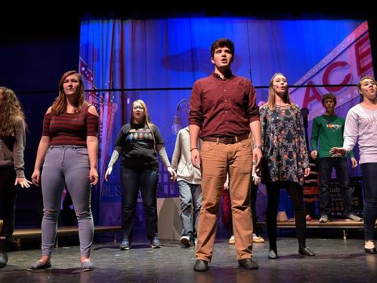 "Dakota Firestone (middle) rehearses ""100 Years of Broadway."""