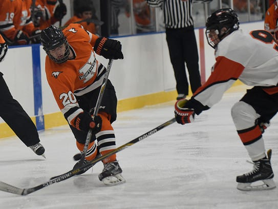 Northville's Danny Scorzo takes a shot while defended
