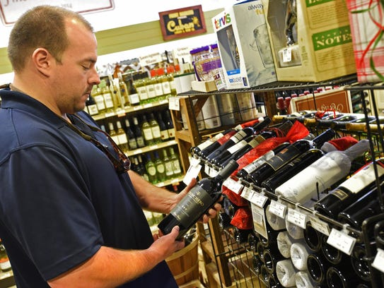 Bryan Procell checks out the wine selection at Shreveport's