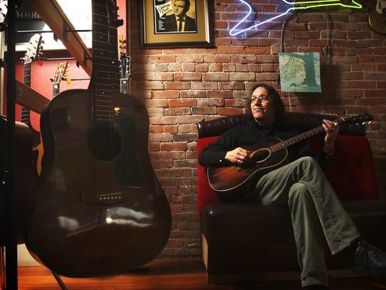 Tim Knight plays a World-War-II-era Gibson acoustic