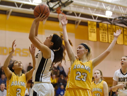 North Farmington senior guard Sophie Muller (left)