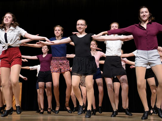 "Dancers tap their way through a scene of ""42nd Street."""