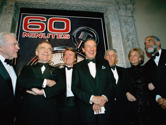 """The """"60 Minutes"""" team poses for photographers at the"""