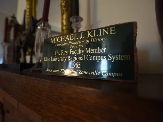 A brick marking Michael Kline's career at Ohio University's
