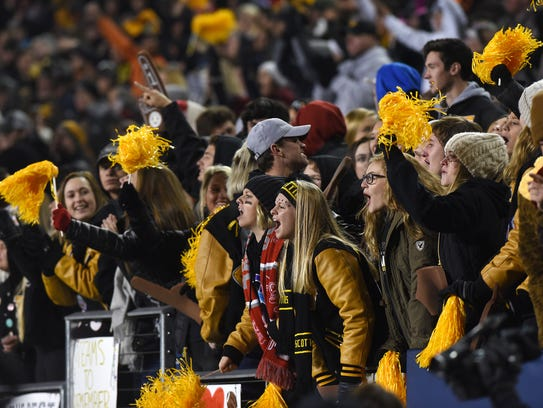 Tri-Valley fans cheer during the Division III state
