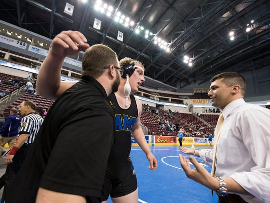 Kennard-Dale's Tanner Harkins hugs his coaches after