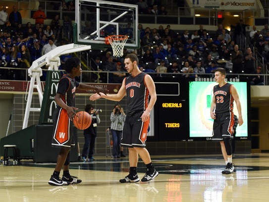 Waverly's Cody Remington gets a high five from teammate