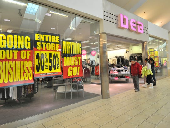 Out of business and discount signs display on the windows