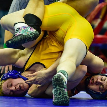 River Valley's Carter Langdon tries to avoid being