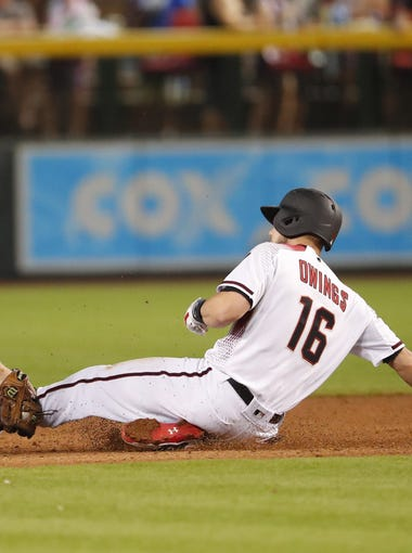Arizona Diamondbacks center fielder Chris Owings (16) is tagged out at second base by Los Angeles Dodgers second baseman Logan Forsythe (11) during the seventh inning at Chase Field in Phoenix April 4, 2018.