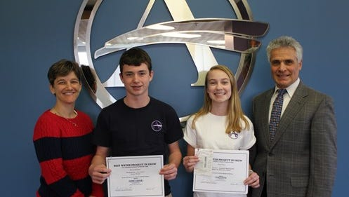 First and second place winners from Sussex Academy School from left to right, teacher Lauren Hvorecny, Trent Sapna, Gabrielle McCormicik and Jerry Esposito, president Tidewater Utilities.