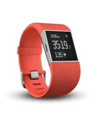 This file photo shows the Fitbit Surge, a fitness tracker with built-in GPS and heart-rate monitors.