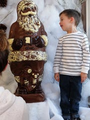 Hunter Schuck looks at the 3-foot-tall chocolate statue at Birnn Chocolates in Highland Park.