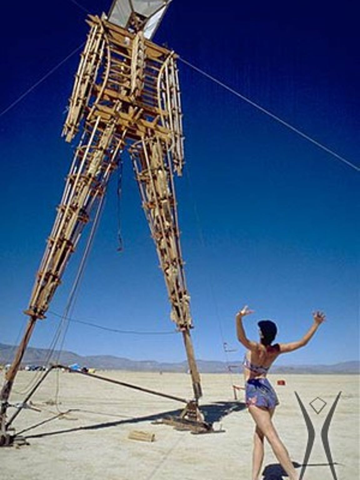 Crimson Rose, one of the Burning Man founders, practices a routine for the man burn in 1991 in the Black Rock Desert.