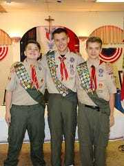 One Eagle and Two Life scouts - Darius Cotter celebrates his becoming the 15th Eagle Scout in his family with brothers Gabriel and Josiah Cotter. By the year 2018, there may be 20 Eagle Scouts in the family.