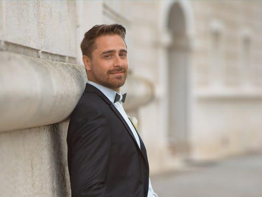 Portrait of groom in wedding costume