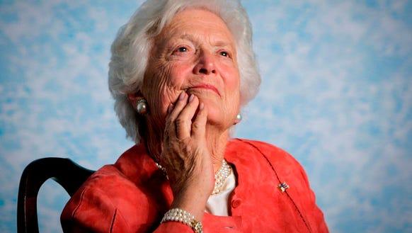 Barbara Bush listens to her son, President George W.