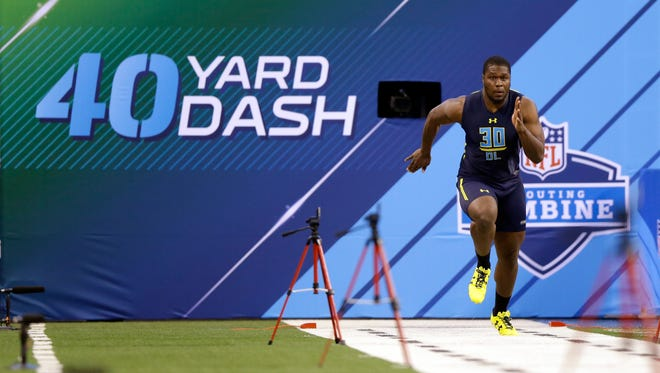 Former Michigan State defensive end Malik McDowell runs a drill at the NFL football scouting combine in Indianapolis, Sunday, March 5, 2017.