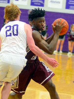 Station Camp High senior forward Yalen Reed maneuvers into the lane as Portland senior Caelum Utley defends during second-quarter action. Reed scored 11 points in the Bison's 54-29 victory.