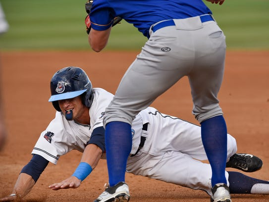 T.J. Friedl of the St. Cloud Rox slides into third