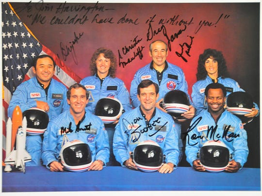 """The Challenger crew signed a photo for mission flow director Jim Harrington of Viera. The inscription reads: """"We couldn't have done it without you."""""""