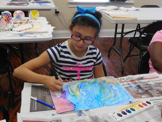 Campers chose colors that reinforced the motion of their Futurist artworks