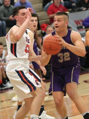 Lexington's Cade Stover makes a shot during a sectional game against Galion at Willard High School on Wednesday night.