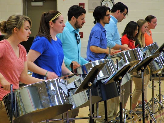 With drumming intensity, the University of Iowa's PanAmerican Steel Band was back in action Thursday afternoon, this time enchanting students during an assembly at North Bend elementary in North Liberty.