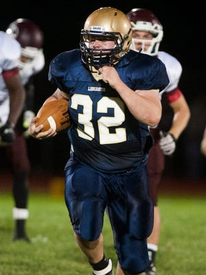 Lancaster Running back Ryan Fitchpatrick runs the ball down the field against Canal Winchester on Friday at Lancaster High School.