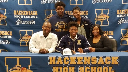 Aubyn Bryan II signs to play football at Wesley University.