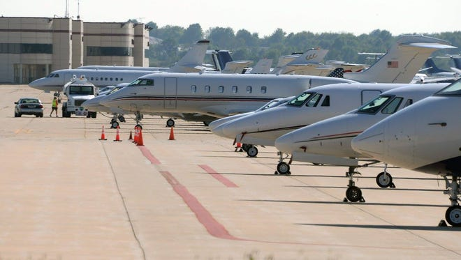 Lines of private jets parked at the Springfield-Branson National Airport on Wednesday Sept. 20, 2017.