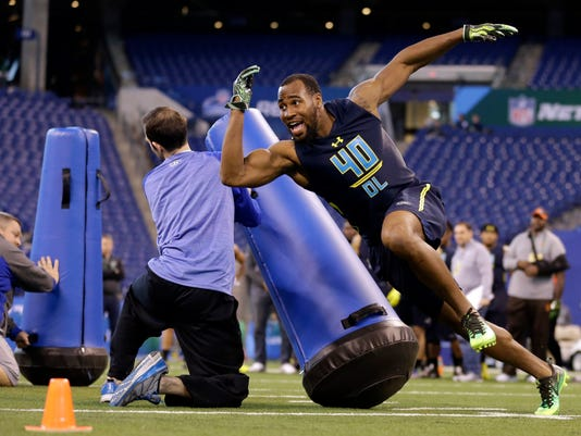FILE - In this March 5, 2017, file photo, Temple's Haason Reddick runs a drill at the NFL football scouting combine in Indianapolis. A case can be made that no player in this NFL draft has benefited more from the process that follows the college football season than Reddick. With stellar showings at the Senior Bowl and combine, the Temple linebacker has gone from a possible first-round pick to a potential top-10 selection. (AP Photo/Michael Conroy, File)