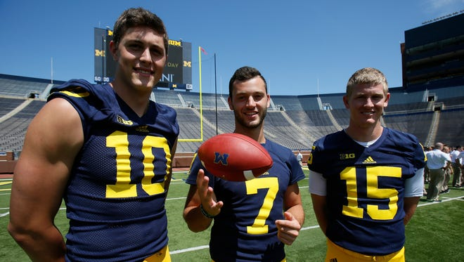 Michigan quarterbacks left to right Zach Gentry, Shane Morris, and Jake Rudock pose for photos during the team's football media day on Thursday, Aug. 6, 2015, in Ann Arbor.