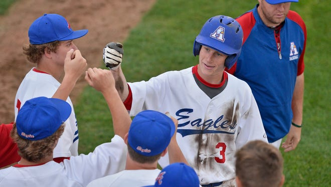 St. Cloud Apollo junior outfielder Peter Nelson (3) celebrates scoring Apollo's second run of the game in the fifth inning Wednesday against St. Cloud Tech at Dick Putz Field. Apollo defeated Tech 3-1.