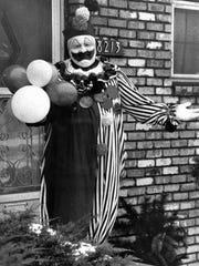 Serial killer John Wayne Gacy poses in a clown costume