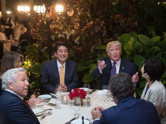 President Trump, Japanese Prime Minister Shinzo Abe, his wife, Akie, first lady Melania Trump and Robert Kraft, owner of the New England Patriots football team, sit down for dinner at Trump's Mar-a-Lago resort in Florida on Feb. 10.