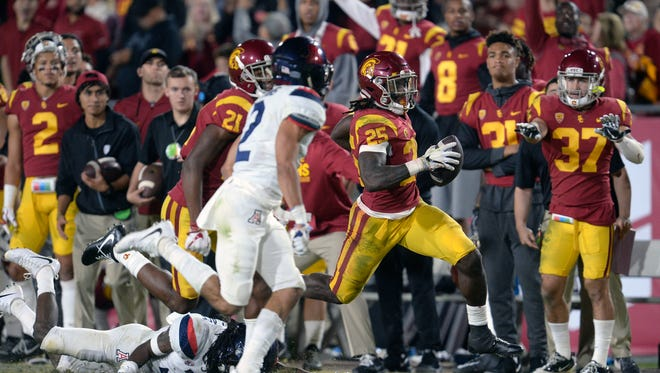 November 4, 2017; Los Angeles, CA, USA; Southern California Trojans running back Ronald Jones II (25) runs the ball against the Arizona Wildcats during the second half at the Los Angeles Memorial Coliseum. Mandatory Credit: Gary A. Vasquez-USA TODAY Sports