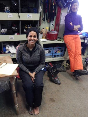 Mona Patel and Shippen Davis-Salas in SAAS room at Ski Apache.
