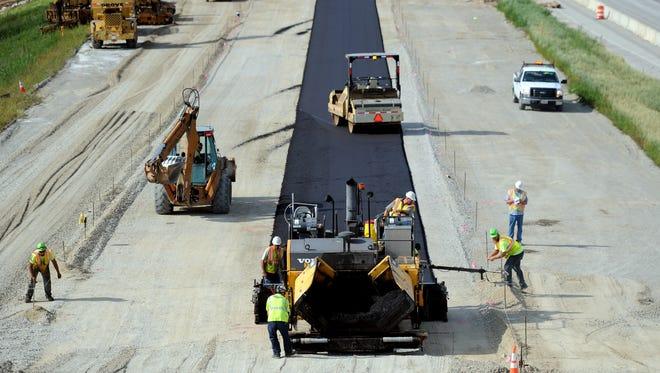 Construction crews work on  northbound Interstate 41.