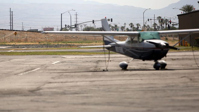 The traffic lights on Jefferson Street in Indio can be seen from the Bermuda Dunes Airport. The City of Indio is considering a site just beyond the light for an orthopedic joint center. Airport officials worry that the site is too close to the airport runway.