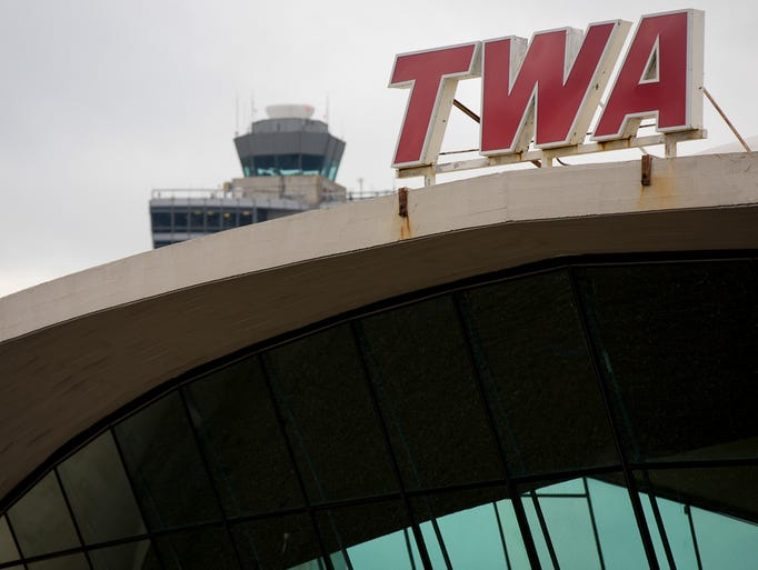 The iconic red-lettered TWA logo stands atop the famous